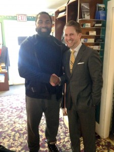 Patriots All-Pro Jerod Mayo thanks Main Street Formals owner Robert Brunelle for preparing the formalwear for the wedding of Mayo's brother, Deron.